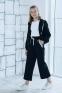 Трикотажный костюм для девочки Filatova, цвет черный 0